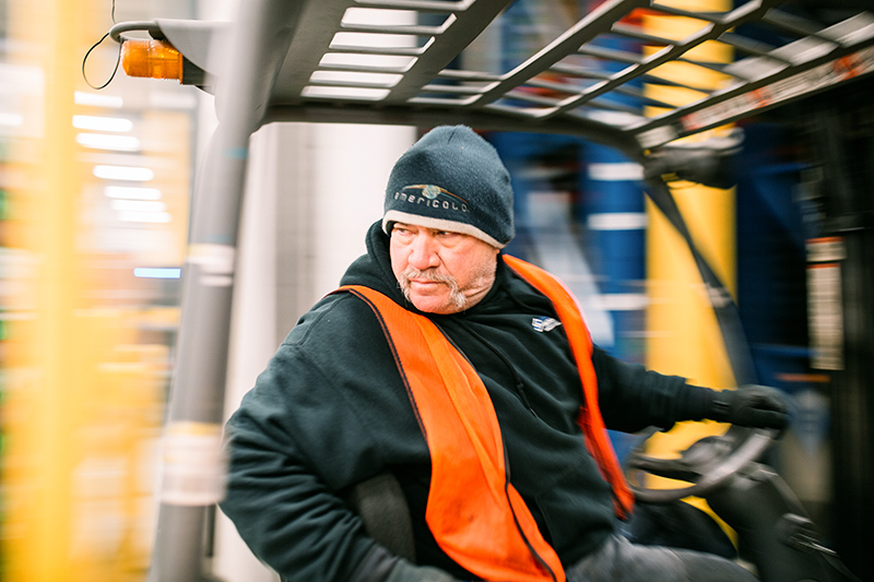 Employee of Americold operating a forklift