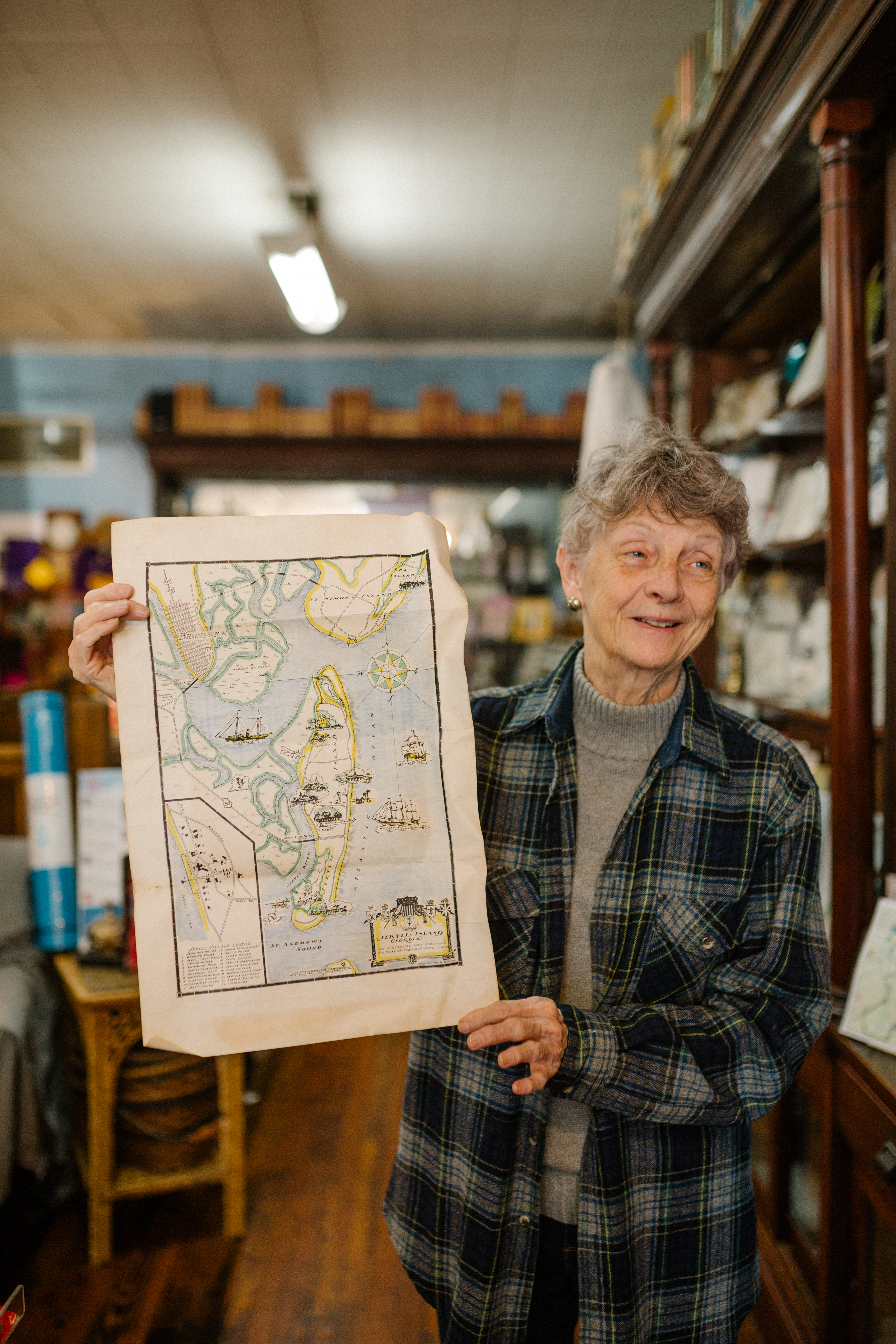 Shop keeper of Horton's Bookstore holding a map.